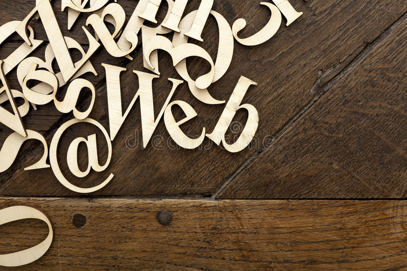 Wooden alphabet letters. On old wooden surface with space for your own text stock photography