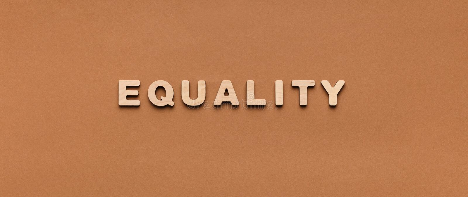 Wooden alphabet letters spelling out word Equality stock image