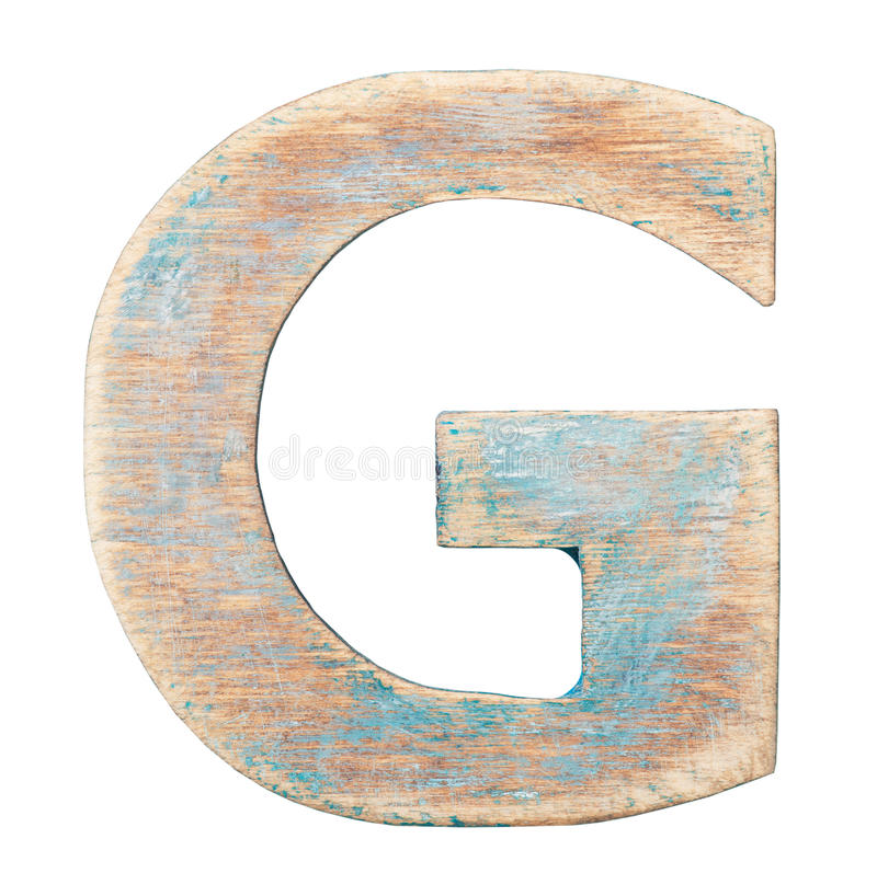 Wooden alphabet. Painted wood alphabet, letter G royalty free stock photos