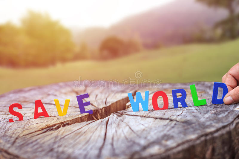 Wooden alphabet SAVE WORLD on tree stump. Love tree or save. Colorful wooden alphabet SAVE WORLD on tree stump. Love tree or save world concept royalty free stock photos