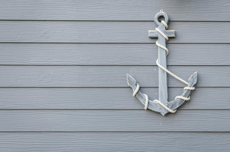 Wooden anchor on wood wall stock image