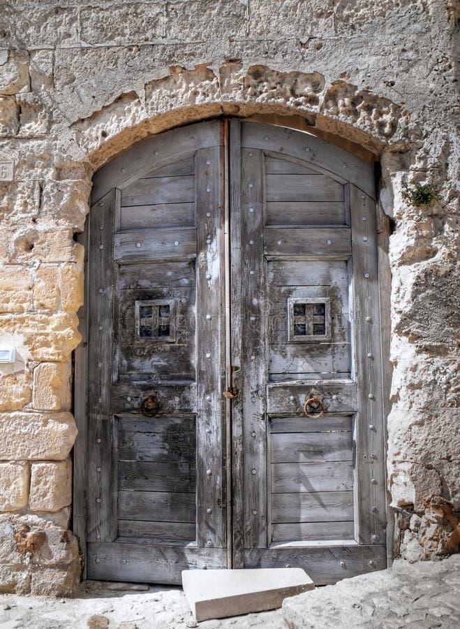 Wooden Ancient Frontdoor. stock images