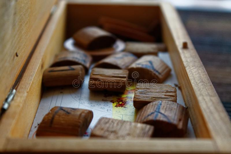 Wooden antique runes in casket. Wooden runes in casket, background for web site or mobile devices royalty free stock images