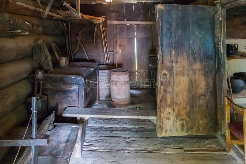 Wooden antiquities for the household in a farmhouse. Barrel old chest and many other things. For your design stock photo