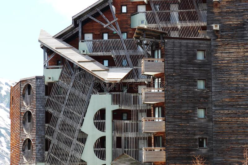 Wooden apartments against white mountains, Avoriaz, France royalty free stock image