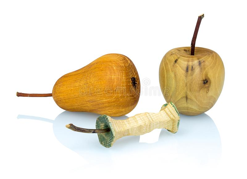 Wooden apple, apple stub and pear made from a different types of wood isolated on white background with shadow reflection. stock image