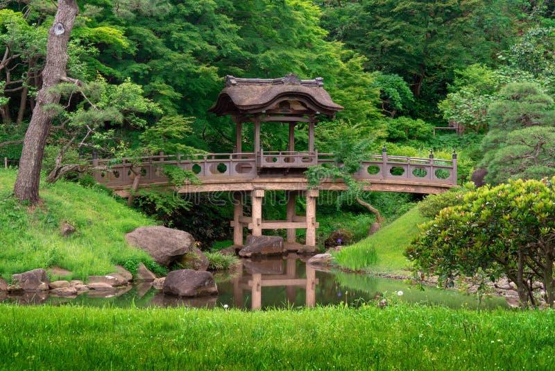 Wooden arch bridge in traditional japanese garden. Yokohama royalty free stock photo