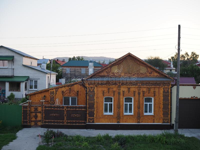 Wooden architecture. Beautiful wooden house with carved decorations on the facade. Russia, khvalynsk - august 2019 royalty free stock photo