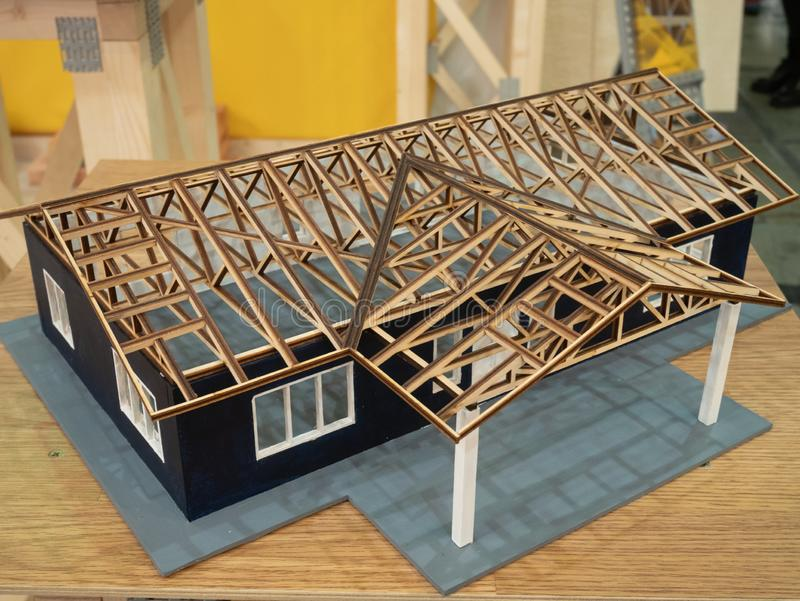 Wooden architecture miniature model project of house skeleton frame without roof cover for presentation, demonstration of building royalty free stock images