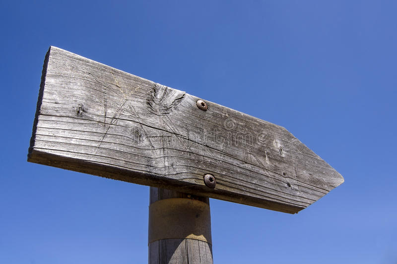 Wooden arrow sign post or road signpost stock image