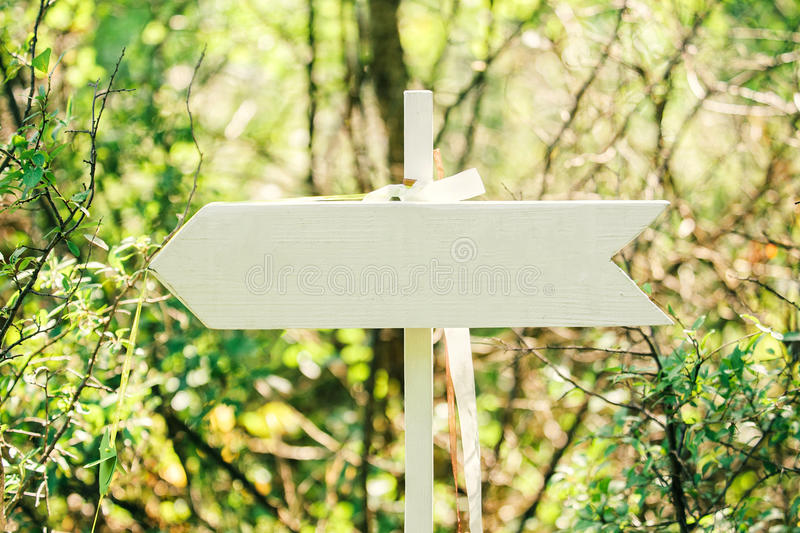 Wooden arrow sign stock photo