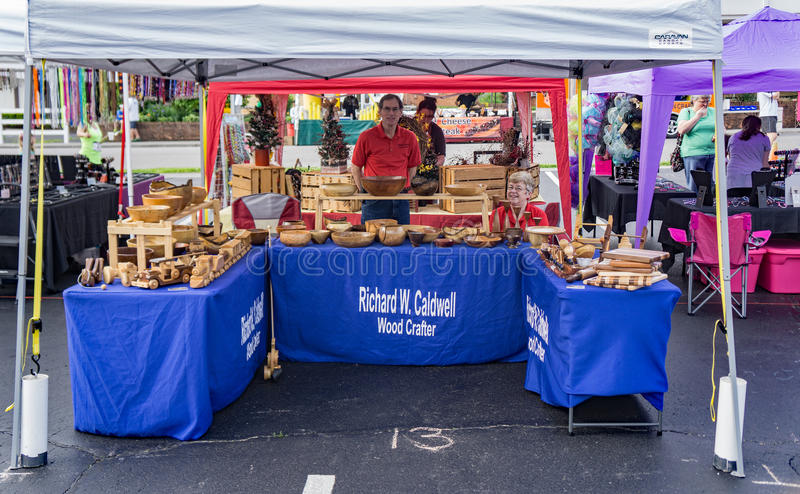 Wooden Artist at the Vinton Dogwood Festival. Vinton, VA – April 29th: Wooden Artist selling his creations at the Annual Dogwood Festival, Vinton, VA on royalty free stock images