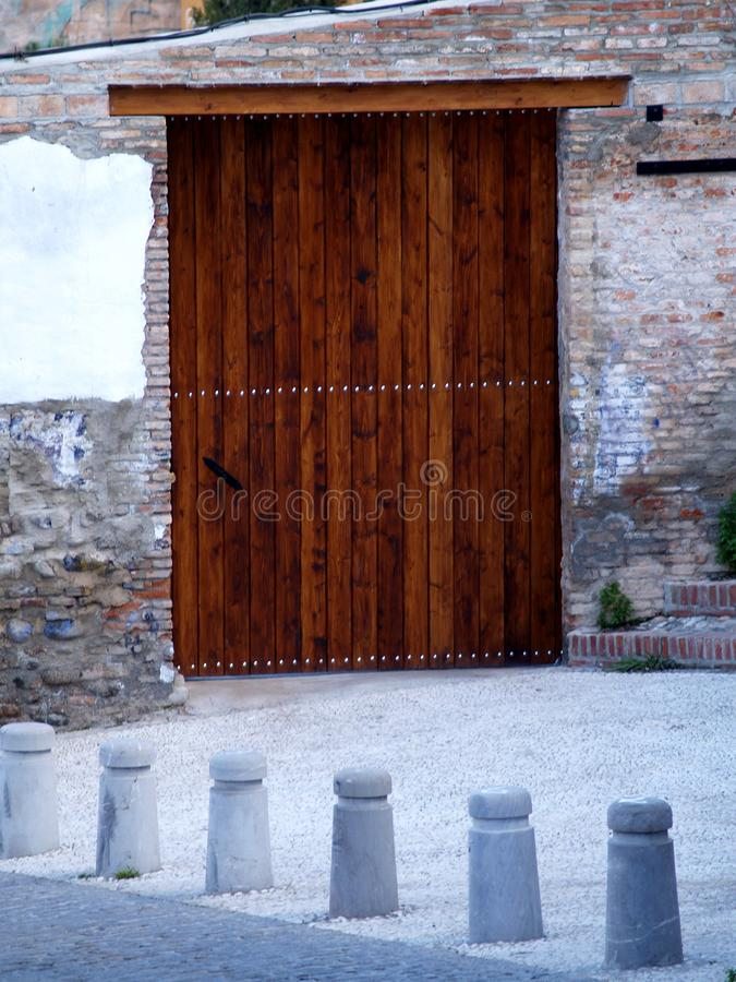 Wooden artistic door on old wall. At Granada, Spain royalty free stock photo