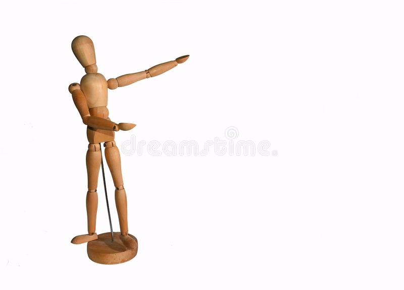 Wooden Artists Manikin on stand pointing at copy space with white background royalty free stock photos