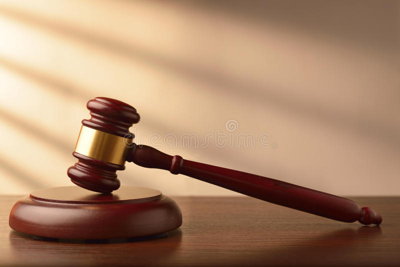 Wooden auctioneer or judges gavel royalty free stock image
