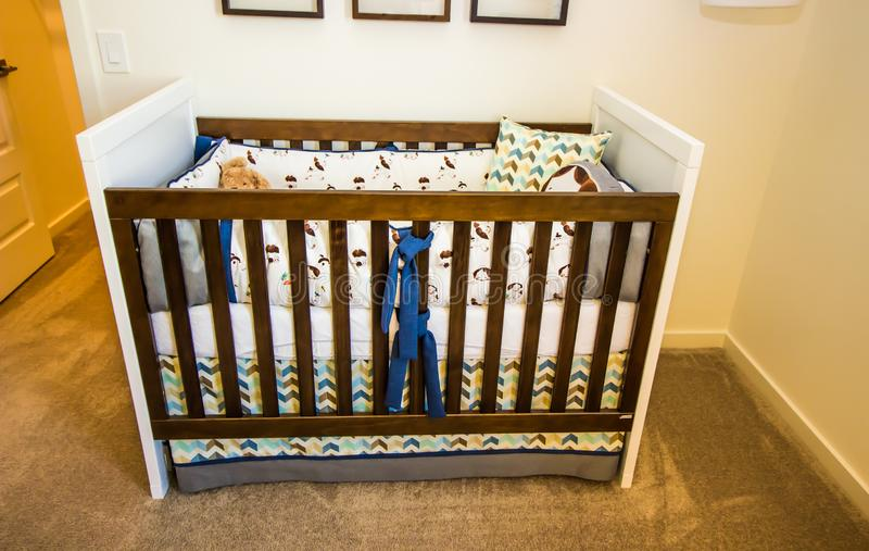 Wooden Baby Crib With Wooden Rails. And Pillows In Bedroom royalty free stock images