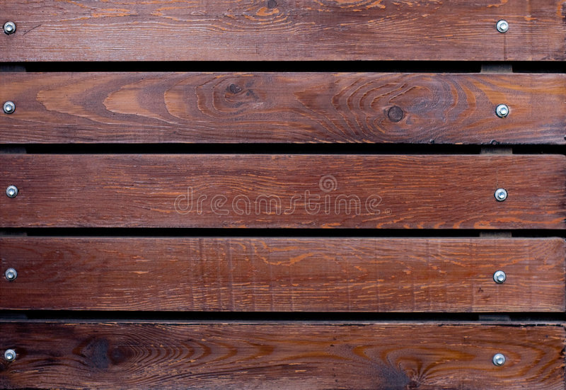 Wooden background. With metal nails stock photography