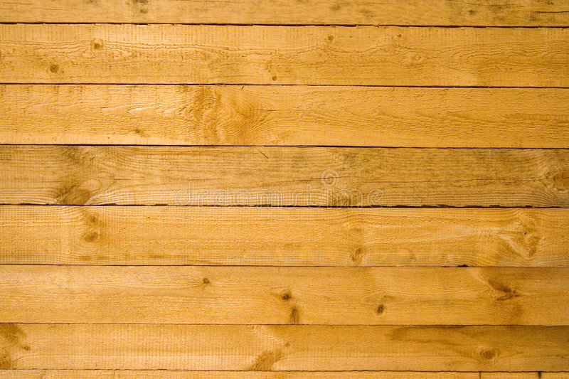 WOODEN BACKGROUND. Wooden wall of yellow color royalty free stock photos