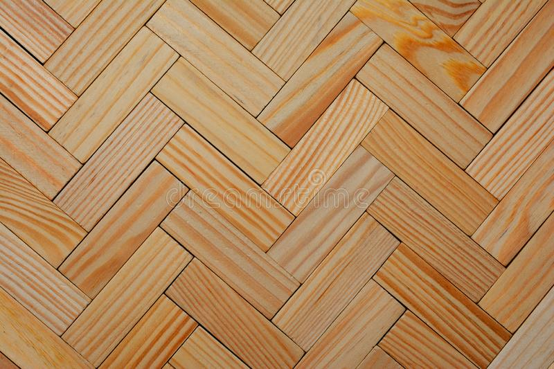 Wooden background consisting of the boards which are laid out in a geometrical pattern.  royalty free stock images