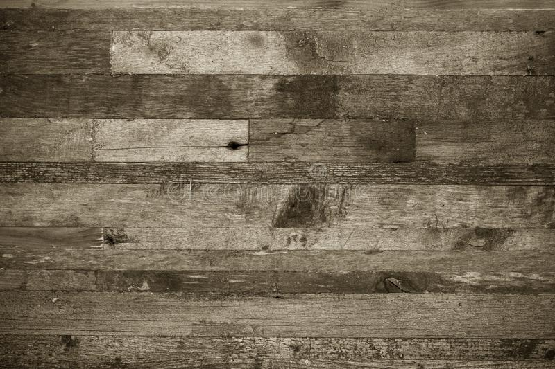 Wooden background from the ends of old boards. Toned stock image