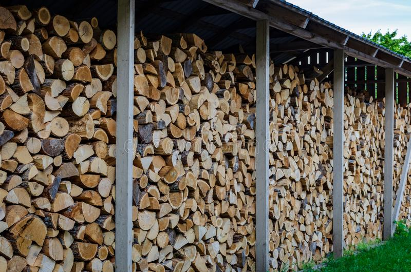 Firewood drying for the winter, stacks of firewood royalty free stock photography