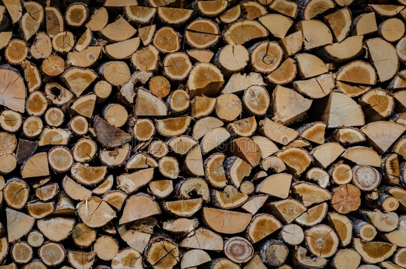 Wooden background. Firewood drying for the winter, stacks of firewood royalty free stock photo