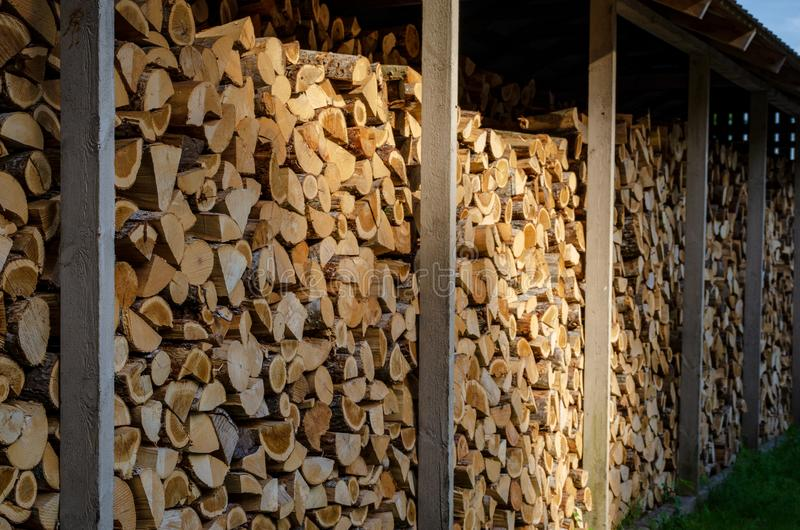 Firewood drying for the winter, stacks of firewood royalty free stock images