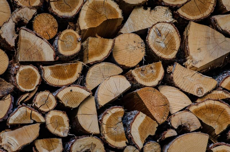 Wooden background. Firewood drying for the winter, stacks of firewood. royalty free stock photography