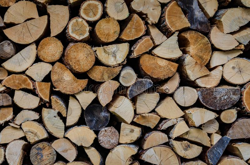 Wooden background. Firewood drying for the winter stock photography