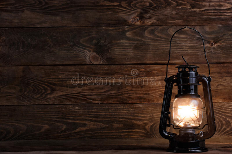 Wooden background and gas lamp royalty free stock photography