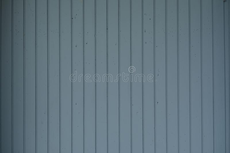 Wooden background from gray vertical narrow boards stock image