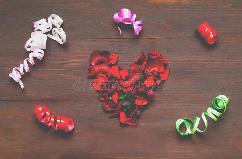 Wooden background with heart from petals of dried flowers and co royalty free stock photo