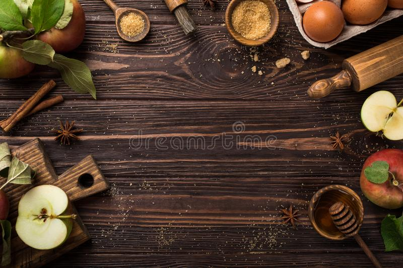 Wooden background with ingredients for baking apple pie. Top view, copy space stock photo