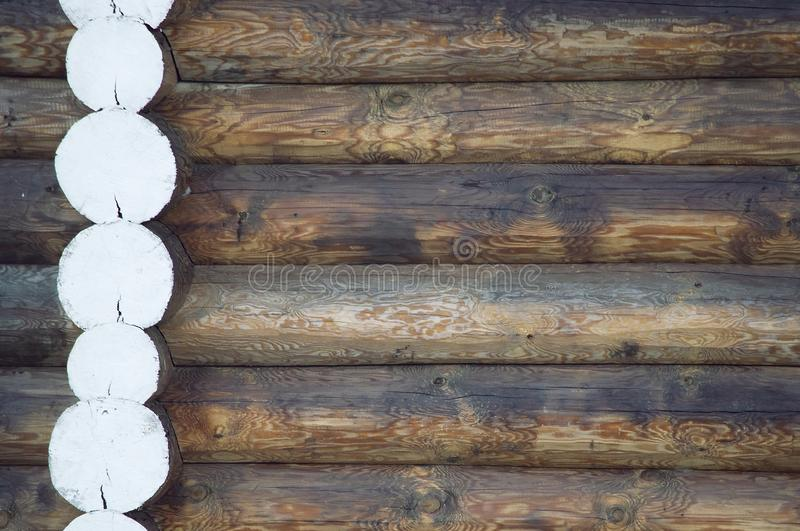 The wooden background of the natural logs in the village stock image