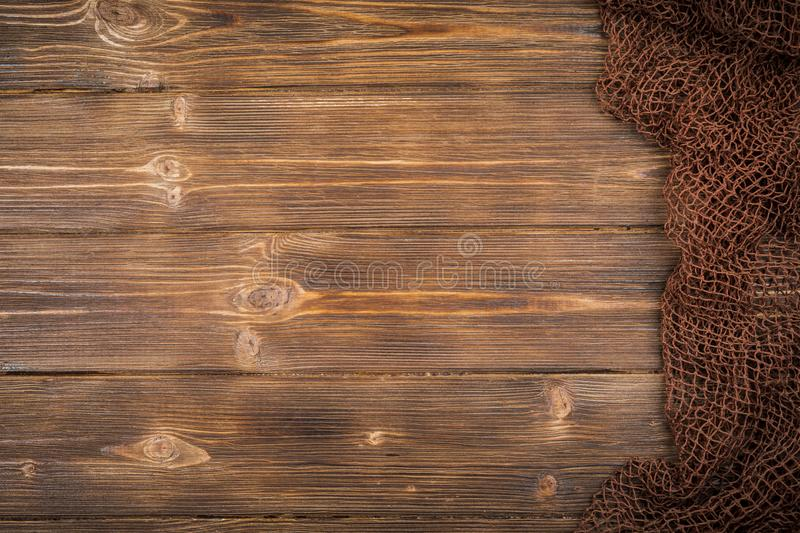 Wooden background with old fishing net. stock photo