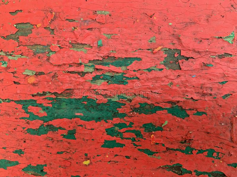 Wooden background with old red paint. Cracked multi-layered paint royalty free stock photos