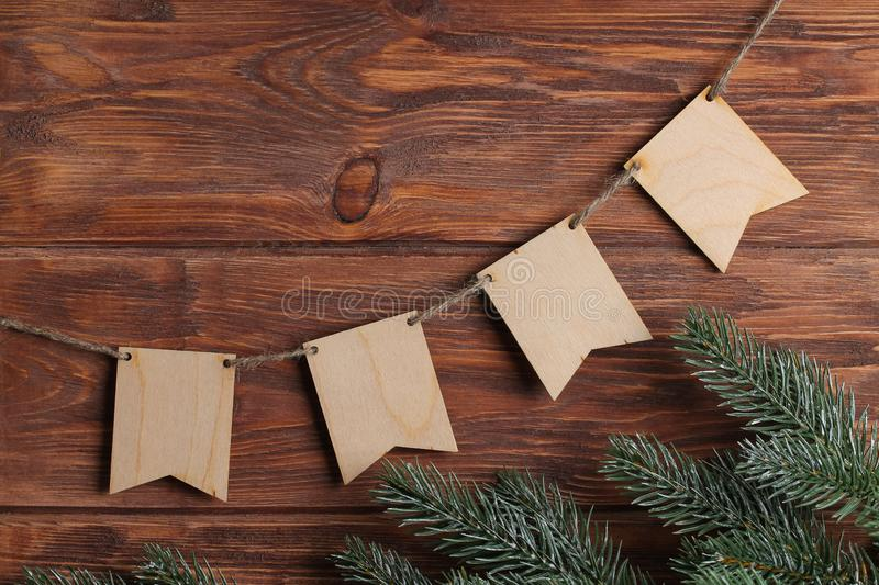The wooden background with spruce branch and four empty flags. royalty free stock photography