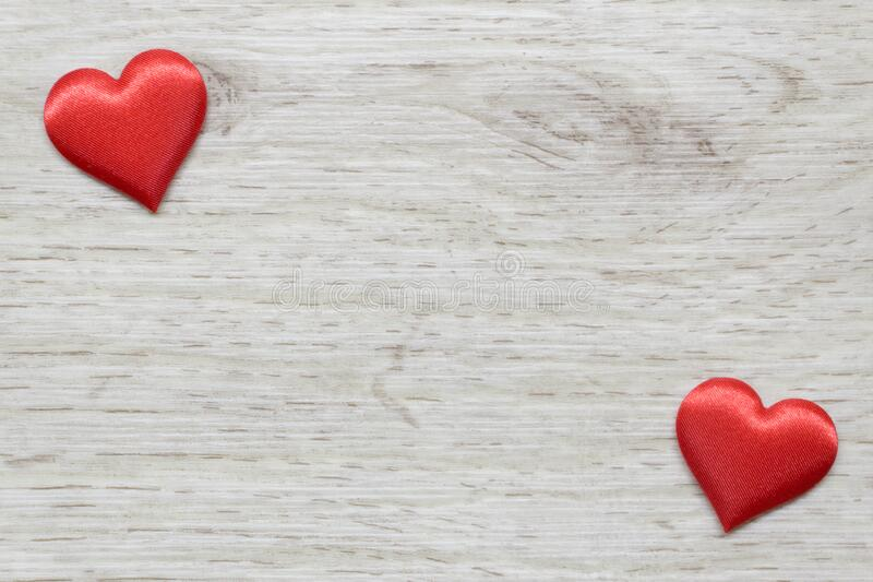 Wooden background with two hearts stock photography
