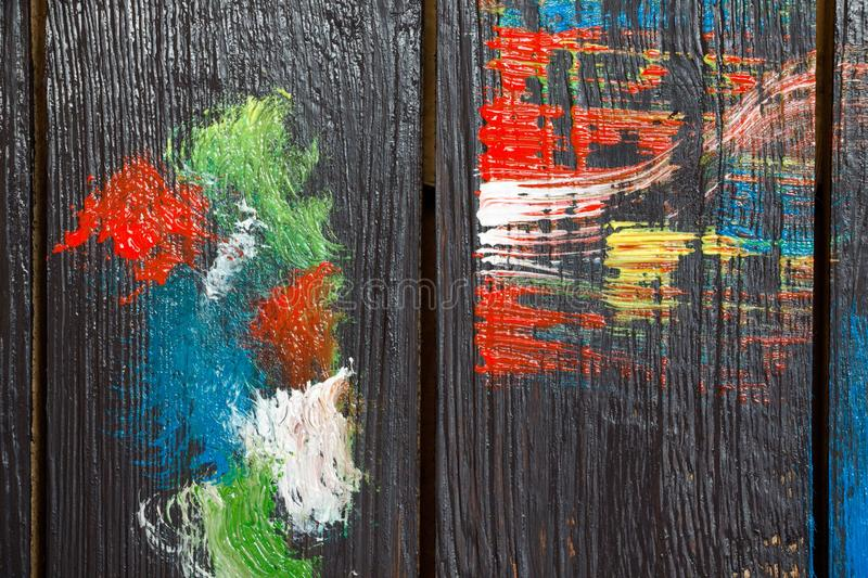 On a wooden background which is painted in black paint stock photo