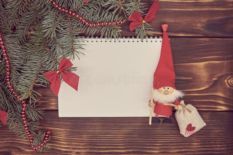 On a wooden background, a white sheet of paper around it Christmas decor stock photography