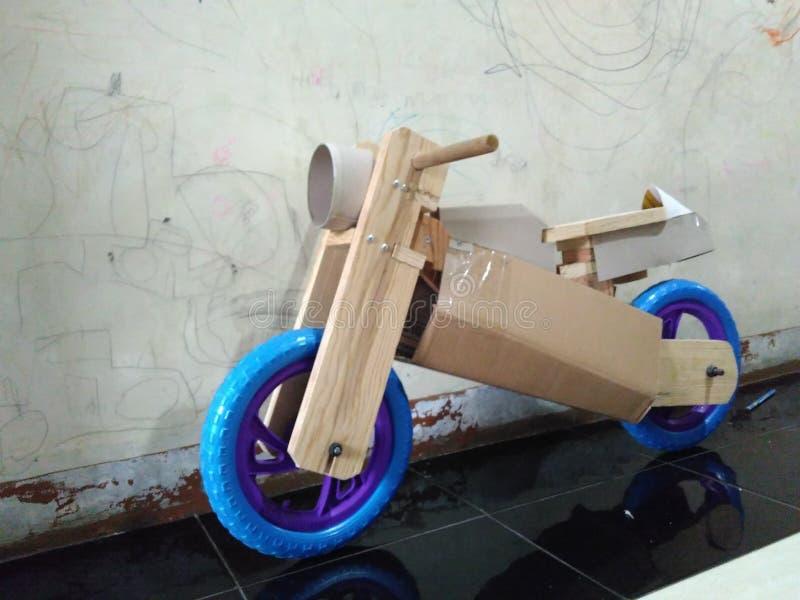 Wooden balance bike. Blue tire stock image