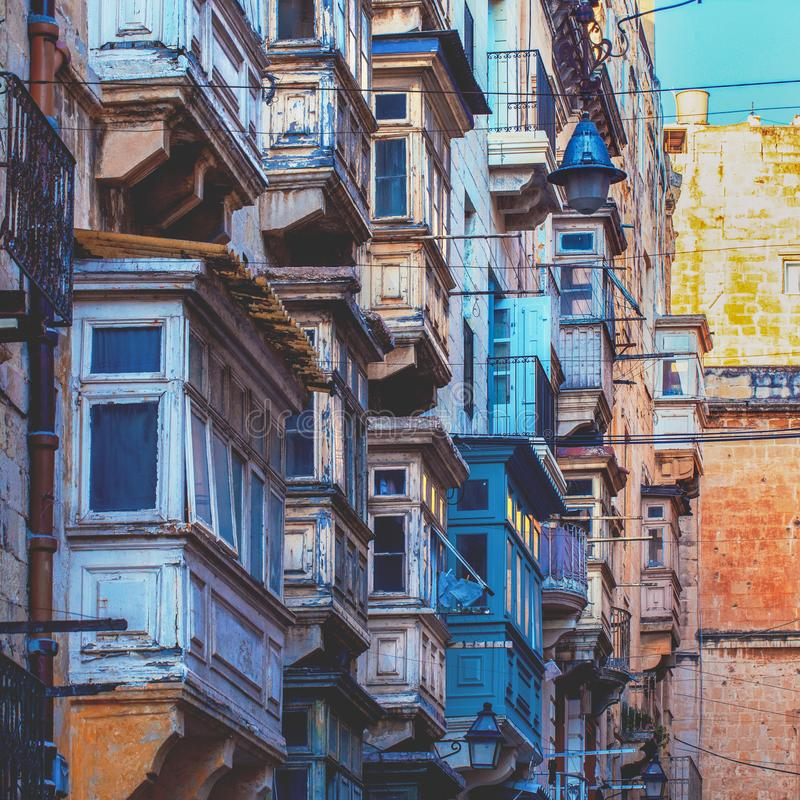 Wooden balconies with windows in Valletta, Malta, cinematic style. Wooden balconies with windows in Valletta, Malta, EU, cinematic style royalty free stock photography