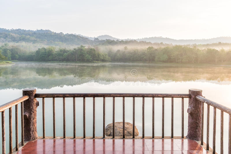 Wooden balcony in front of lake on the morning stock photos