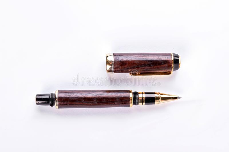 Wooden ballpoint pen, white background. royalty free stock photography