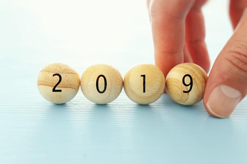 Wooden balls and cubes with the digits 2019 - New Year, success and planning concept. Wooden balls and cubes with the digits 2019 - New Year, success and royalty free stock photography