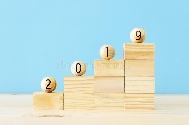 Wooden balls and cubes with the digits 2019 - New Year, success and planning concept. Wooden balls and cubes with the digits 2019 - New Year, success and royalty free stock image