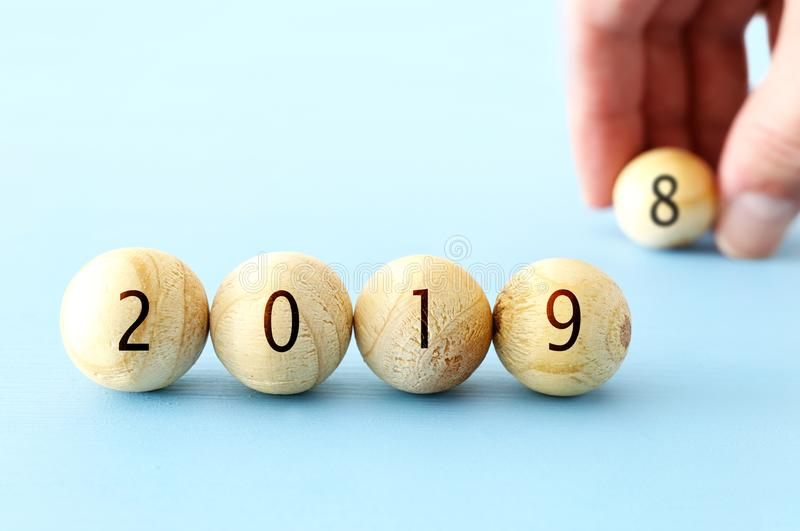 Wooden balls and cubes with the digits 2019 - New Year, success and planning concept. Wooden balls and cubes with the digits 2019 - New Year, success and royalty free stock images