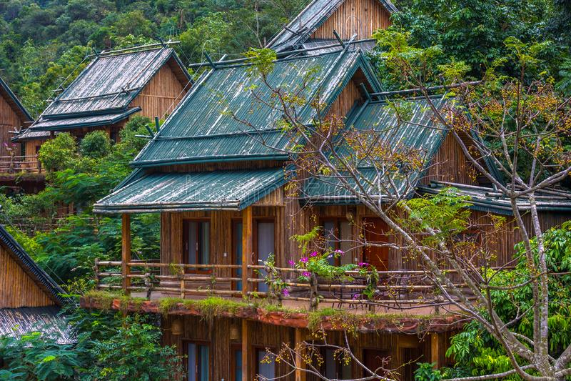 Wooden bamboo houses in the jungle. Sanya Li and Miao Village. H. The jungle is the most interesting thing that there is on the Sanya island for the traveler royalty free stock photos