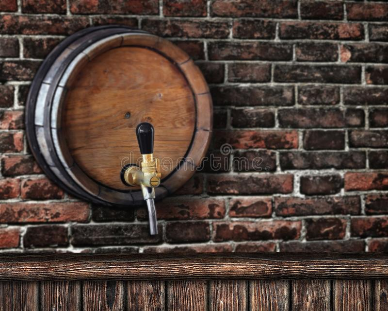 Wooden bar counter with beer barrel in the background stock image