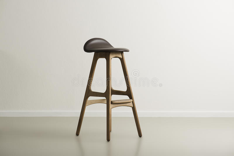 Wooden bar stool with a molded leather seat royalty free stock photos